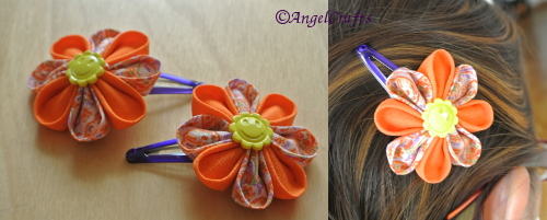 Handmade Kanzashi Flower Hairclip - made with cotton cloth. Flower measures 5.5cm, purple-blue hairclip measures 5cm. End to end measures 7.7cm. Single layer design with yellow sun center. Retail Price: $18 - yours for simply sharing our FB page and getting your friends to LIKE us.