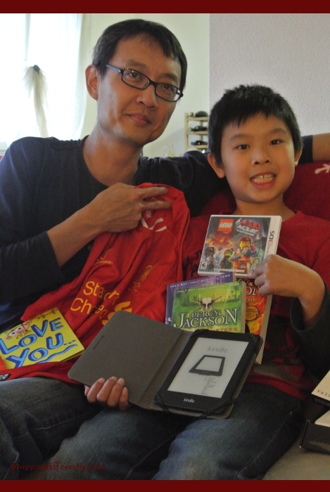 He received a 3DS game, Percy Jackson books, Liverpool jersey, a Kindle and red packets from his grandparents. Not pictured - tickets to a David Garette concert!