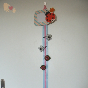 Ladybug-Heart Hairbow Holder - US$20.00 - makes for a great organiser for all those pretty hariclips.