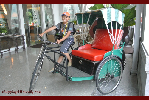 Riding a rickshaw at The Clifford Pier, which was the jetty where most people landed coming into Singapore in the 50s and 60s...