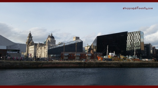 The view from Albert Dock, looking at the Open Eye Museum (the modern building) and the 3 Graces; the Liver Building, the Cunard Building and the Port of Liverpool Building.
