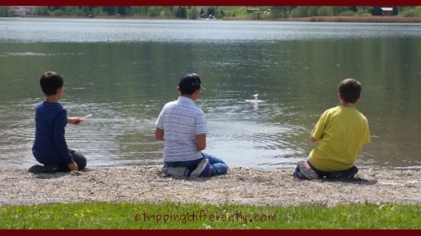 i love this shot of them, trying to skip stones on the lake.