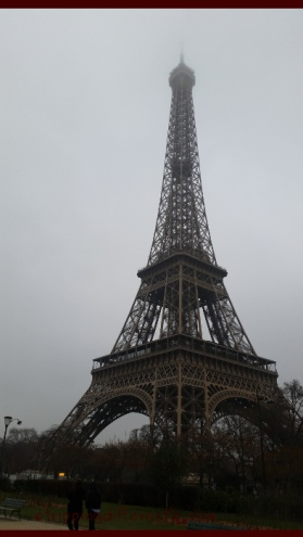 The famous Eiffel Tower on a foggy Parisian morning.
